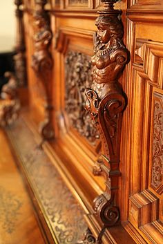 An art cased, Oscar Gerbstadt upright piano with an ornately carved Romanesque style, case. Entire piano cabinet is covered with high relief, carvings of female warriors, lion's heads, corinthian pilasters, fish, acanthus and oak leaves. Incredible example of German hand craftsmanship - at Besbrode Pianos