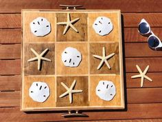 Learn to make this crafty and multi-purpose coastal tic-tac-toe board game and serving tray. Offer guests a simple, conversation-friendly game with whimsical. Coastal Style, Coastal Decor, Coastal Living, Tic Tac Toe Board, Hand Sander, Wood Putty, Wooden Serving Trays, Easy Home Decor, Wood Glue