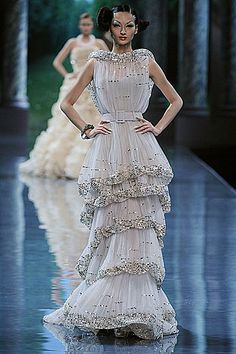 John Galiano for Dior...Beautiful details. Pick 1-3 details to recreate for that unique wedding dress. Ask your dressmaker for suggestions.