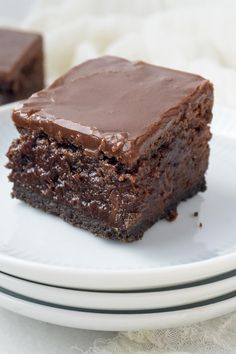 Decadent and irresistible, these are The Ultimate Triple Layer, Fudgy Brownies! Dense, fudgy brownies with an Oreo cookie base and a satiny, chocolate fudge glaze.