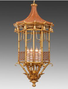 The Federalist Designs -Metal and wood pagoda design lantern. Shown in standard antiqued gold metal leaf finish with custom distressed red top and accents.