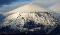 The lenticular cloud formation creates a breathtaking image over the conical-shaped Klyuchevskaya Sopka mountain in east Russia. (Photo: Ivan Dementievskiy) Klyuchevskaya Sopka is a stratovolcano, the highest mountain on the Kamchatka Peninsula of Russia and the highest active volcano of Eurasia. The volcano is part of the natural Volcanoes of Kamchatka UNESCO World Heritage Site.