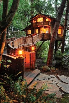 This treehouse was featured in the February 2006 Architectural digest magazine. Built as a family guesthouse in the Swiss chalet style, its ramp is supported by salvaged Madrona logs with a bench 1/2 way up. Has running water, sleeps four people, restored leaded glass windows, and many other unique features... check out more photos at TreeHouseWorkShop.com