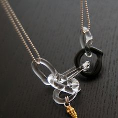 Experimental glass jewelry design: glass rings and metal necklace