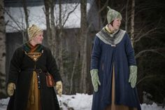 Norwegian women in the winter with Birka-style coats. Note the woven or naalbinding scarves tucked into the open neckline for warmth