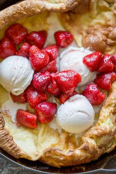 Strawberry Dutch Baby, also known as a German Pancake topped with Grand Marnier soaked Strawberries and Vanilla Bean Ice Cream - easy and delicious! German Pancakes, Pancakes Easy, Pancakes And Waffles, Easy Desserts, Delicious Desserts, Dessert Recipes, Yummy Food, What's For Breakfast, Breakfast Dishes