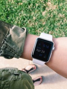 wearing the white Apple Watch Sport edition