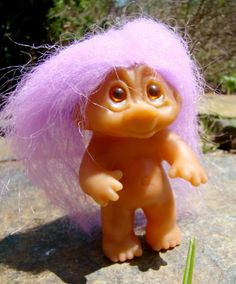 Naked and purple - an iconic Dam troll - I think it was a Norfin, because of the eye design. Also little and SO sweet!
