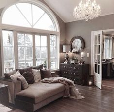 French doors, a mediocre chandelier, high ceilings and the wall color (if real) is perfect. Cozy and clean (Furniture can go)