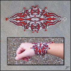"(2013), 2.75"" x 7"", size 15 seed beads (black, transparent garnet, silver-lined ruby, transparent crimson ab), black 2mm bi-cone crystals, blood-red crystal rondelles, Fireline Nice, dramatic winte..."