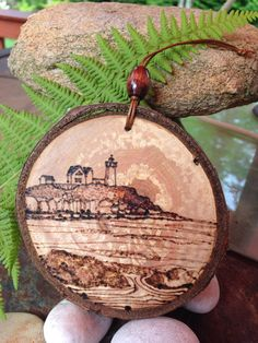 Nubble Lighthouse, Maine pyrography wood burned ornament created by Sandy Blanc for sale on Etsy.