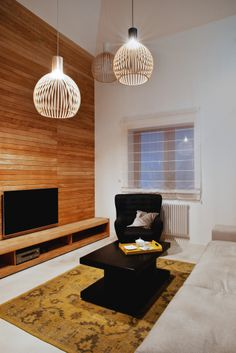 Wooden planks in living room. Secto design llights.