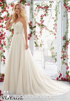 A beautiful lace and tulle wedding dress with romantic details.