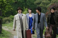 BAEK Yoon-sik, KIM Hye-soo, and CHO Seung-woo in TAZZA: THE HIGH ROLLERS (Tajja, 타짜, The War of Flowers). Available on R1 DVD - Sept. 18, 2012    Tazza: The High Rollers   © 2006 CJ Entertainment Inc. and IM Pictures Corp.