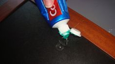 If you have problems hanging photo frames as straight as you'd like try using this tip of dabbing of toothpaste on the end of the picture hook.