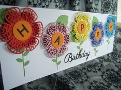 Tattered Lace Happy Birthday. Made using Lavish Blooms Poppy and leaves dies, with Memory box dies stems and Britannia dies sentiment. Flower centres cut with cuttlebug alphabet dies.