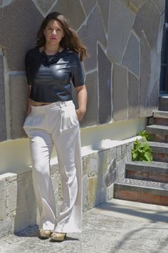 Black and white pants. Leather crop top Ivory wide leg pants