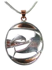 This wonderful dolphin pendant is handmade using using a combination of copper and silver. http://www.annabelchaffer.com/products/Dolphin-Pendant.html