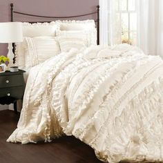 """4-piece ruffled comforter set.   Product: Queen: Comforter, bed skirt and 2 standard shamsKing: Comforter, bed skirt and 2 king shamsCalifornia King: Comforter, bed skirt and 2 king shamsConstruction Material: 100% PolyesterColor: IvoryFeatures: Layered ruffles Dimensions: Standard Sham: 20"""" x 26"""" eachKing Sham: 20"""" x 36"""" eachQueen Comforter: 90"""" x 92""""King Comforter: 92"""" x 104""""California King Comforter: 92"""" x 104"""" Note: Shams do not include insertsCleaning and Care: Dry clean"""