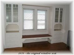 Open space under the window seat - easier than trying to direct the heat, doesn't really hide the heater.