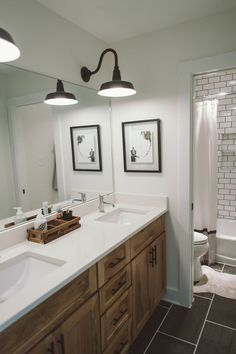 White top, hickory vanity. But nickel accent not bronze. Lighter tile.