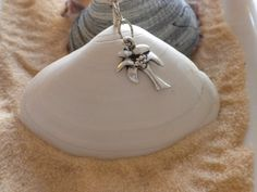 She handpicks seashells and makes her jewelry with them.  Cool!