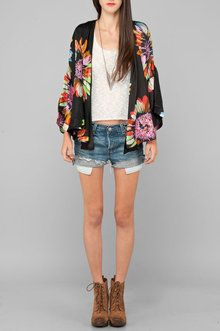 flowery drape sweater. goes with any jeans to spruce up any look.