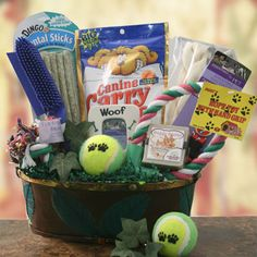 """Dog Eat Dog World  Pet Gift Basket - Dog    As they say, It's a Dog Eat Dog World out there! GeEt their tails a waggin with this basket packed with Canine Carry Out treats, dental sticks chew bones, rope toy with grip, tennis ball, a rubber brush, adjustable collar, chew bone, doggie devine soap and a """"woof"""" themed photo frame."""