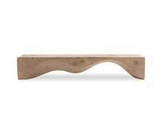 Bench made from a single block of aromatic cedar. Unique wavy and sinuous movement that evolves through an interplay of fullness alternated with emptiness.The products are made from completely natural leather and hand-finished without the addition of any treatment. Movements, cracks and changes in the appearance of the wood are intrinsic characteristics of these items and result from the natural settlement and diverse environmental conditions.