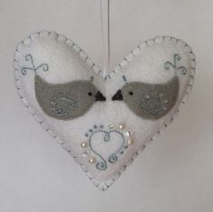This adorable felt heart ornament was hand-stitched, appliqued,  embroidered