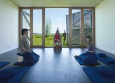 Buddhist Meditation Center Looks Like a Giant Barn With Many Windows in Rural Netherlands