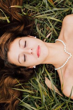 Woman in White Tube Dress Lying on Green Grass in Closed Eyes