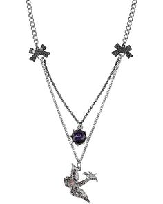 """ICONIC AMETHYST SNAKE GEM NECKLACE: Flaunt your flair for eclectic glamour with this chic frontal necklace. Crafted in antique silver-tone mixed metal with glimmering glass crystals. Silver tone necklace chains with bows. Silver tone bird with purple colored crystal accents. Amethyst colored crystal gem. 16"""" long + 3"""" extender 1"""" bird width 2.25"""" frontal drop $38.00"""