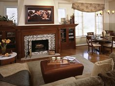 To blend modern technology with classic arts-and-crafts style, the flat-panel TV is mounted in a wood frame so it matches the fireplace and cabinets. Design by Bonnie Sachs.