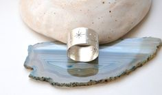Stars and Milky Way wide band ring from sterling silver or brass.  This item is fully handcrafted. It is made from sterling silver or brass sheet. Stars are hand sawed with every tiny detail. Beautiful texture is applied so the ring surface looks like the galaxy. The ring is formed