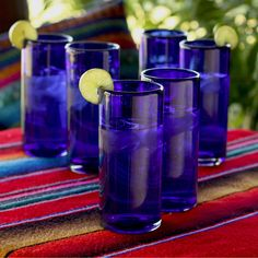 If you and your friends enjoy getting together on a hot summers day to drink homemade lemonade, then you will love these exquisite, cobalt-blue, blown highball glasses. Each glass is individually blown meaning that each is uniquely crafted.