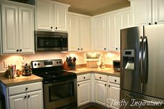 love this kitchen transformation!  she used the Rustoleum countertop transformation kit and cabinet kit too.  and installed a wallpaper beadboard backsplash :)