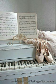 Piano, sheet music, and dance shoes