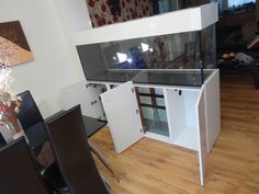 Marine room divider tank with sump.