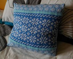This stranded knit cushion features three colourwork bands with repeating patterns and comes in two sizes, 14 inch and 16 inch, you can use as few as two different colour yarns or as many as you like!
