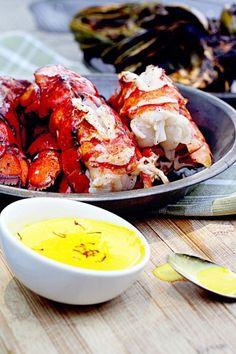 Grilled Lobster Tails With Saffron Butter - lobster tails - canola or grapeseed oil - saffron threads - 2 eggs - garlic clove - lemon - salt - pepper - extra virgin olive oil