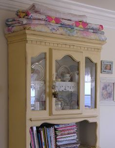 multi-use hutch - love the quilts on top