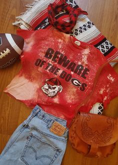 College apparel gameday shirt for University of Georgia Bulldogs Vintage Denim, Vintage Tops, Gold Formal Dress, College Apparel, Pink And White Dress, Game Day Shirts, Distressed Tee, University Of Georgia, Novelty Print