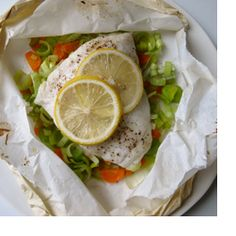 Lemony Flounder in Parchment - Steaming keeps the fish moist and the veggies bright. Plus the parchment pocket makes you feel like you're opening a present when you sit down to dinner!