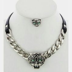 """Fabulous Necklace & Earrings set! Updated pics """"Eye of the Tiger"""" necklace & earrings set is fashionable and unique. Trendsetter piece! Metal and faux leather with jeweled eyes on both the necklace and earrings. Necklace is short and sassy! Inoj Boutique Accessories"""