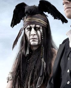 Johnny Depp as Tonto in the film 'The Lone Ranger'.  Follow the link attached to this image and read about how minorities are cast in Hollywood.