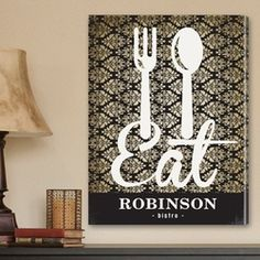"Personalized Family Bistro Canvas  $69.99 on Sale for $59.49  A charming black and ivory filigree background and bright white text make this personalized canvas print perfect for your home bistro. Stylish and modern, it combines the delicate style of vintage wallpaper with bold iconic text for a customized piece of canvas art that both you and your guests will be sure to love.    CANVAS SIZE: 18"" x 24"" x 1/2"""