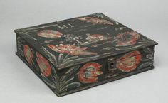 """Pook & Pook.  April 20th & 21st 2007. Lot 392.  Estimated: $3K - $4K. Realized Price: $3978. Heinrich Bucher (late 18th/early 19th c.), Berks County, Pennsylvania, rectangular painted and decorated pine storage box with hinged lid and tin hasp, the lid with house and tulip decoration, inscribed """"H.L."""", the sides with tulips, all on a black ground, 2 3/4"""" h., 10 1/2"""" w, 9 1/2"""" d. Provenance: Hattie Brunner."""