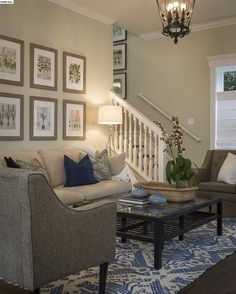 Lovely living room with grand staircase.