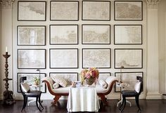 One wall of Dransfield & Ross's grand living room is hung with campaign maps commissioned by Napoleon himself.